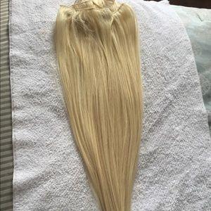 Platinum blonde clip-in hair extensions